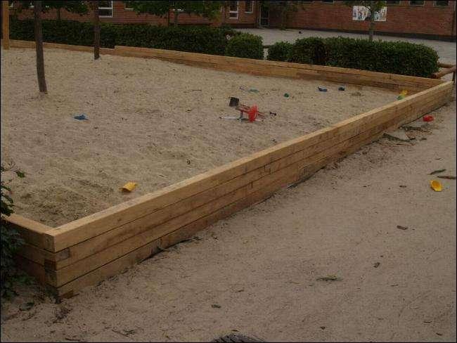 sandkasse kant lavet med sveller